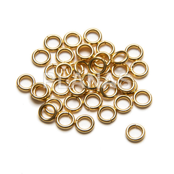 Stainless steel and gold plated rings. 5x0.8mm. bags of 500 units.