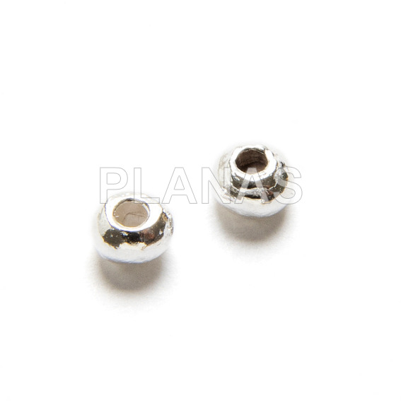 3mm sterling silver donut with 1mm hole.