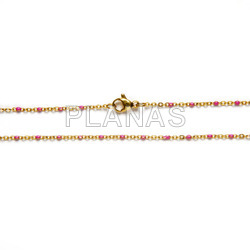 Chain in stainless steel and gold bath with enameled balls. 45cm.