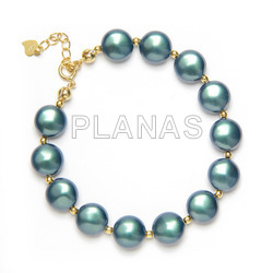 Bracelet in sterling silver and gold bath with 10mm swarovski pearls.