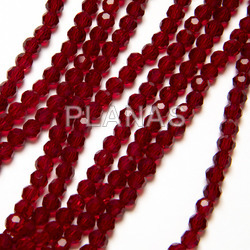 Balls in glass strips faceted 4mm.