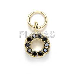 Mini pendant with black zircons in sterling silver circle.